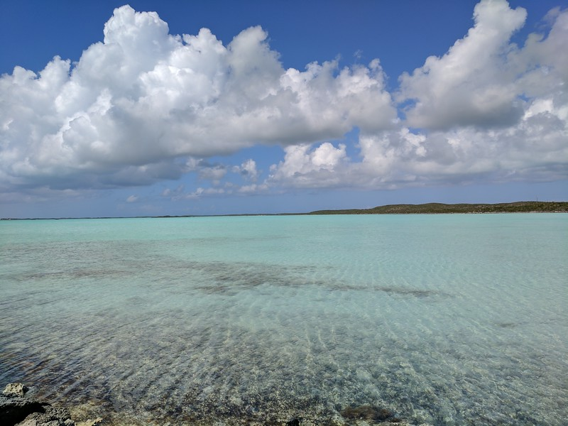 Boomer travel - beach vacations - Chalk Sound​ in Turks and Caicos offers calm, clear water for your boomer travel adventure.