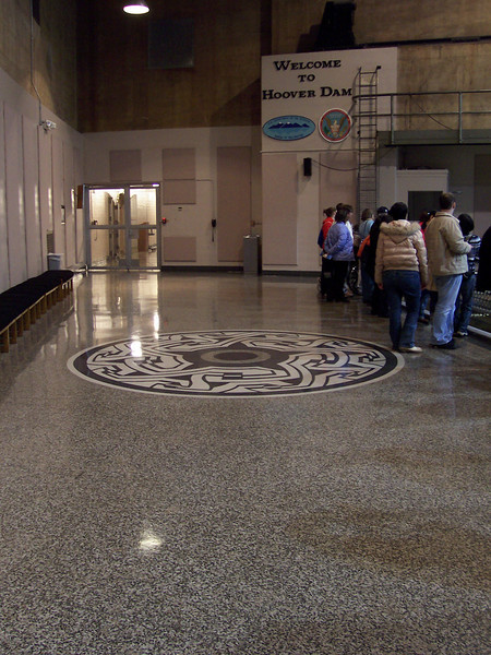The marble floor with art work.