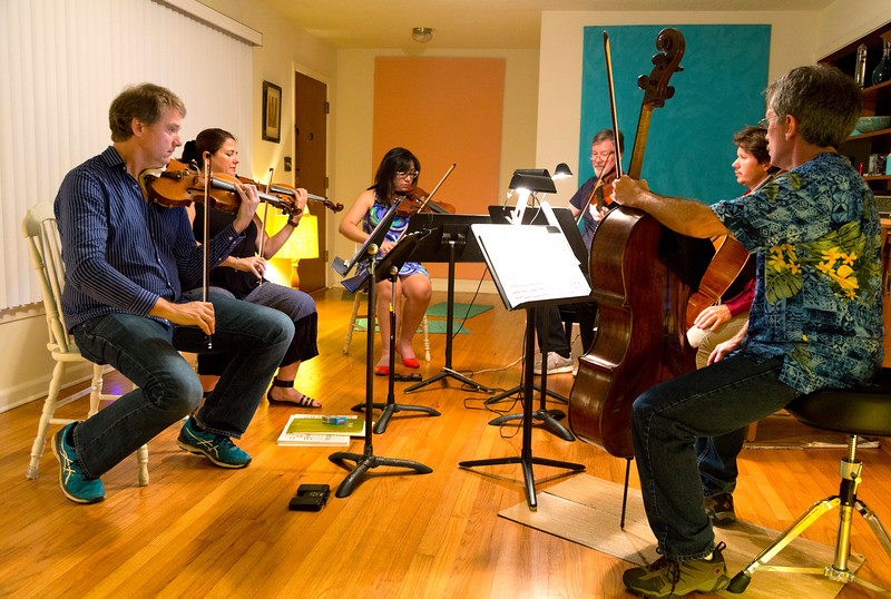 Full sextet, some  playing, some at rest