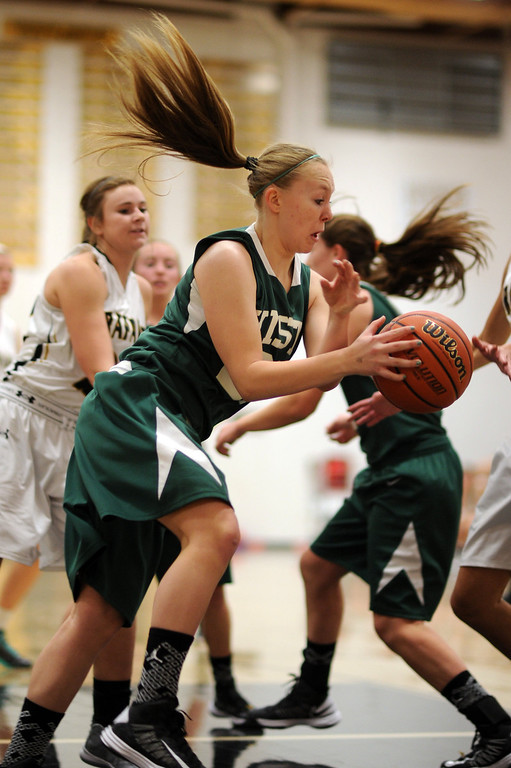 . Mountain Vista\'s Chelsea Pearson, front controls the rebound in the first half of the game at Arapahoe High School Gym onSaturday, Jan. 5, 2013, in Centennial, Colo. Arapahoe won 74-38. Hyoung Chang, The Denver Post