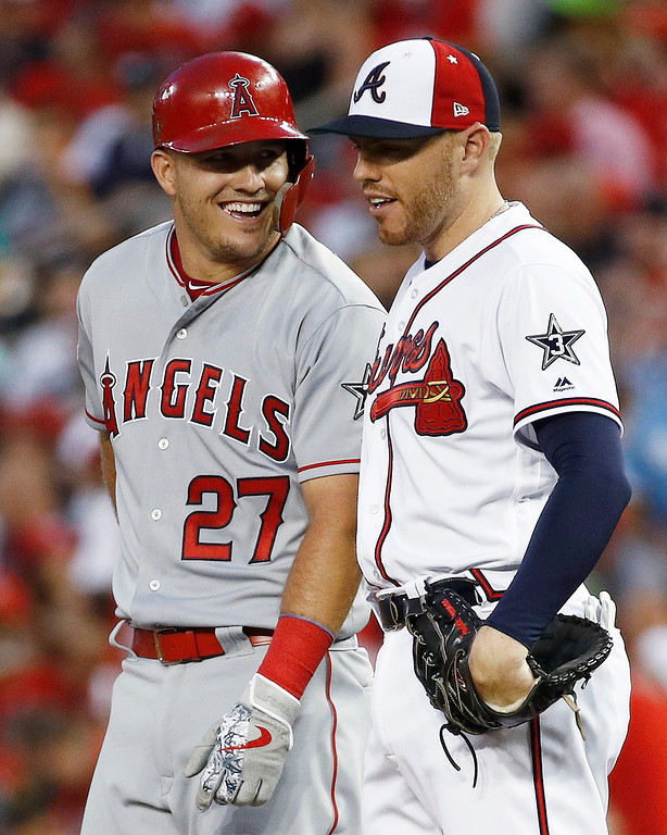 . Los Angeles Angels of Anaheim outfielder Mike Trout (27) talks with Atlanta Braves first baseman Freddie Freeman (5) during the Major League Baseball All-star Game, Tuesday, July 17, 2018 in Washington. (AP Photo/Patrick Semansky)