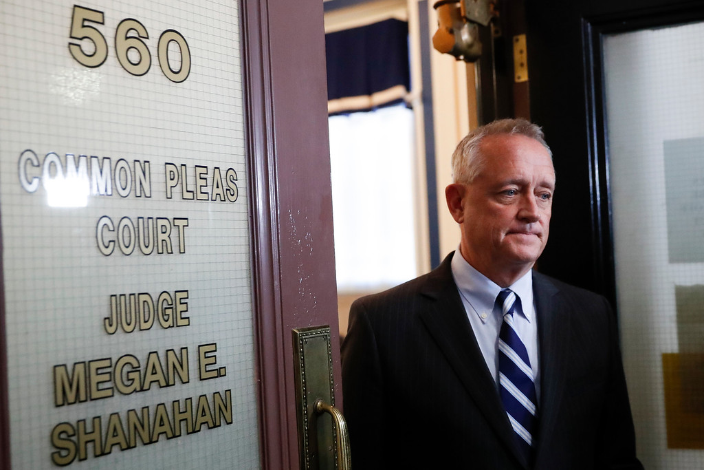 . Hamilton County Prosecutor Joseph Deters leaves court after Common Pleas Court Judge Megan Shanahan declares a mistrial due to a hung jury in the murder trial against Ray Tensing, Saturday, Nov. 12, 2016, in Cincinnati. Tensing, the former University of Cincinnati police officer, is charged with murdering Sam DuBose while on duty during a routine traffic stop on July 19, 2015. (AP Photo/John Minchillo)
