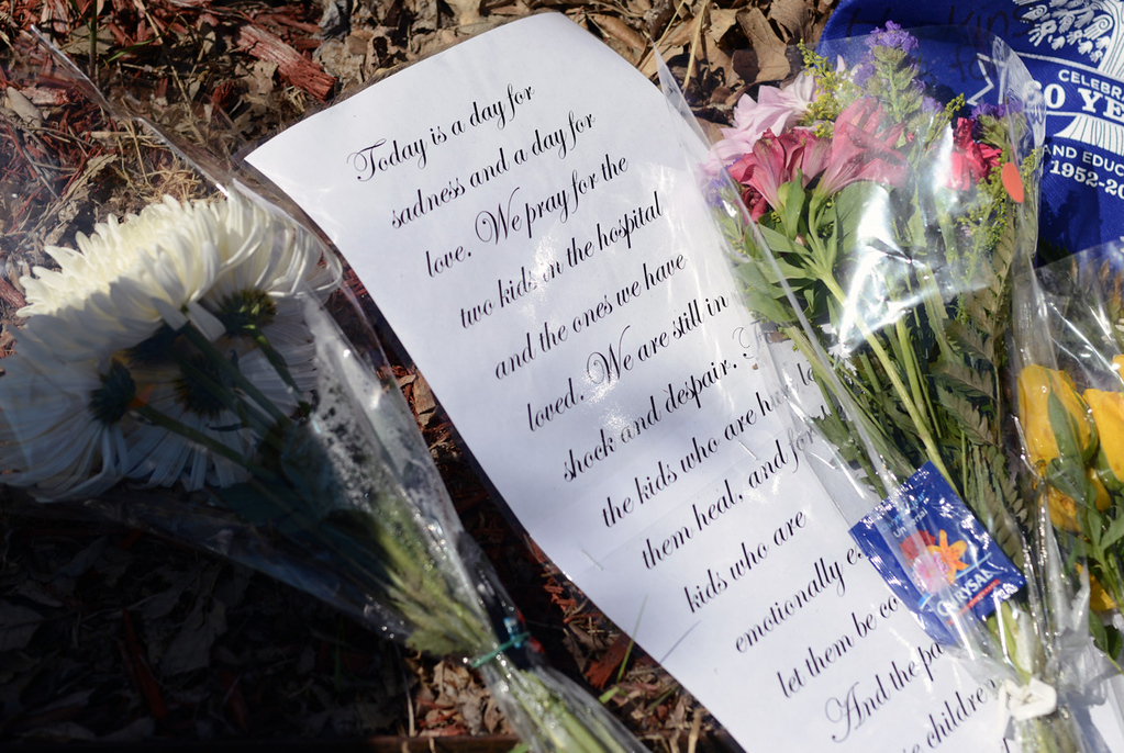 . A personal note was among some of the items left at a makeshift memorial in front of Peter Hobart Elementary School in St. Louis Park on Thursday, in memory of the two students who died in a landslide while on a field trip to Lilydale Regional Park in St. Paul on Wednesday. (Pioneer Press: Chris Polydoroff)