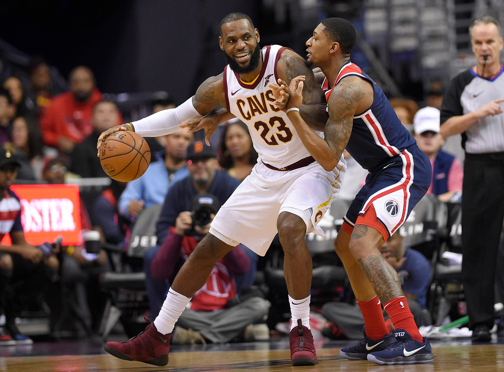 . Cleveland Cavaliers forward LeBron James (23) dribbles against Washington Wizards guard Bradley Beal, right, during the second half of an NBA basketball game, Sunday, Dec. 17, 2017, in Washington. (AP Photo/Nick Wass)