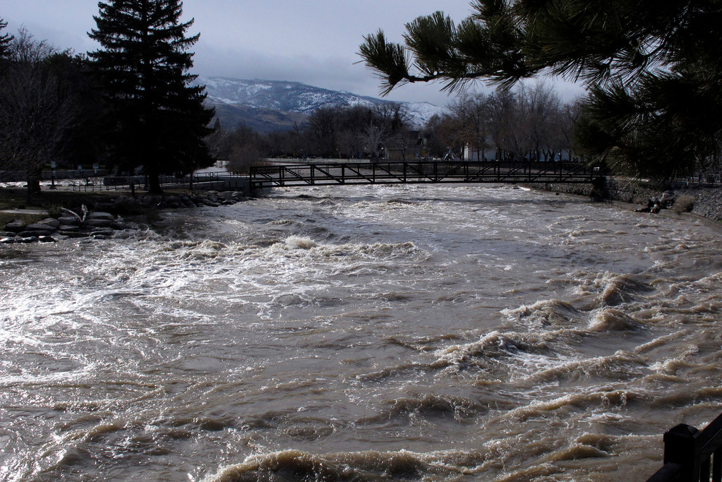 . The Truckee River surges through downtown Reno, Nev., Monday, Jan. 9, 2017, after floodwaters crested earlier in the day. Most bridges that had closed were reopened. (AP Photo/Scott Sonner).