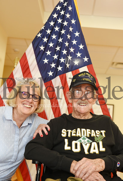 Harold Aughton/Butler Eagle: Linda Rodriguez spends time with her father Elmer Glenn, 95, at the Butler VA Community Living Center. Glenn served in the 4th infantry division of U.S. Army during WWII.