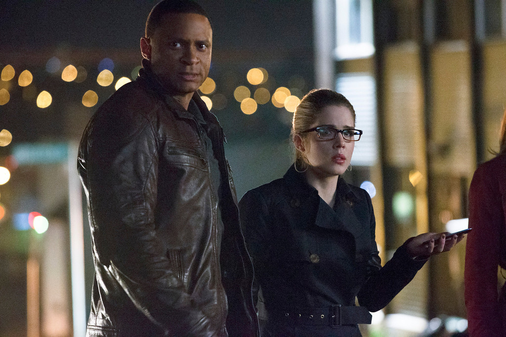 """. David Ramsey as John Diggle and Emily Bett Rickards as Felicity Smoak in The CW\'s \""""Arrow.\""""  (Photo by Jack Rowand/The CW -- © 2014 The CW Network, LLC. All Rights Reserved.)"""