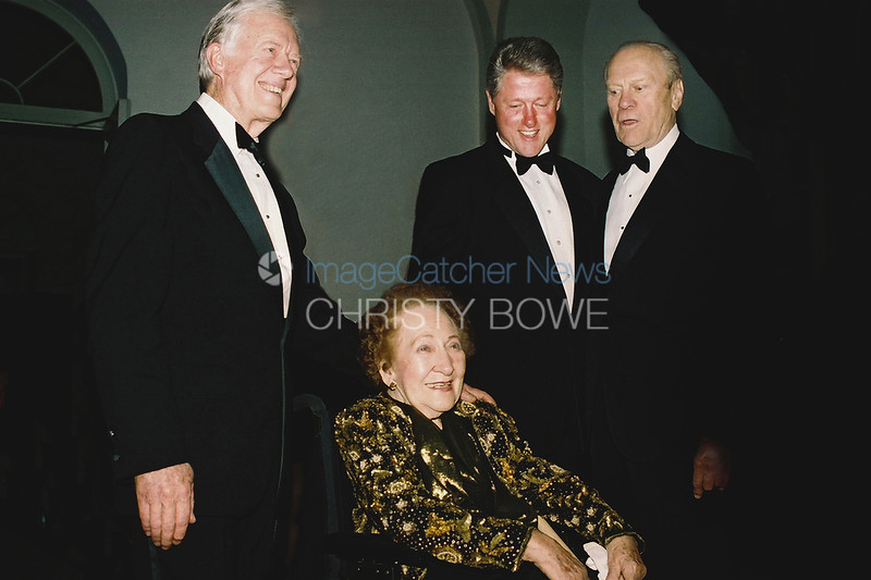 Reporter Sarah McClendon poses with Presidents Carter, Clinton and Ford at the National Building Museum.