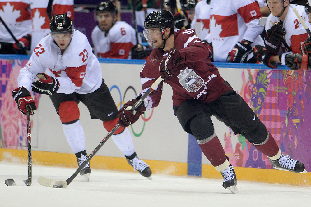 . Lauris Darzins (10) of the Latvia controls the puck as Jamie Benn (22) of the Canada defends during the third period of Canada\'s 2-1 win over Latvia. Sochi 2014 Winter Olympics on Wednesday, February 19, 2014 at Bolshoy Ice Arena. (Photo by AAron Ontiveroz/ The Denver Post)