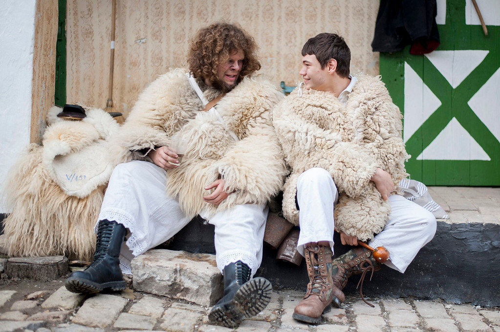 . Young revelers wearing sheep-fur costumes chat as they get ready for the traditional carnival parade in the yard of a house in Mohacs, 189 kms south of Budapest, Hungary, 27 February 2014.   EPA/TAMAS SOKI