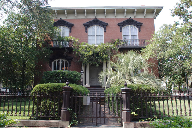 The infamous Mercer House, built by Johnny Mercer's great grandfather and home to Jim Williams and his annual Christmas party that was the premier social event among Savannah's elite.  This is the scene of much of _Midnight in the Garden of Good and Evil_, including the sensational shooting of local hustler Danny Hansford by Williams.  © Shams Tarek (www.shamstarek.com)