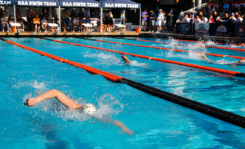 . Kali Kearns, left, swims in the Girls 200 Yard Freestyle race in the CIF-SS Division 4 Swimming Championship Finals held at Riverside Community College pool on Friday, May 10, 2013. (Rachel Luna / Staff Photographer)
