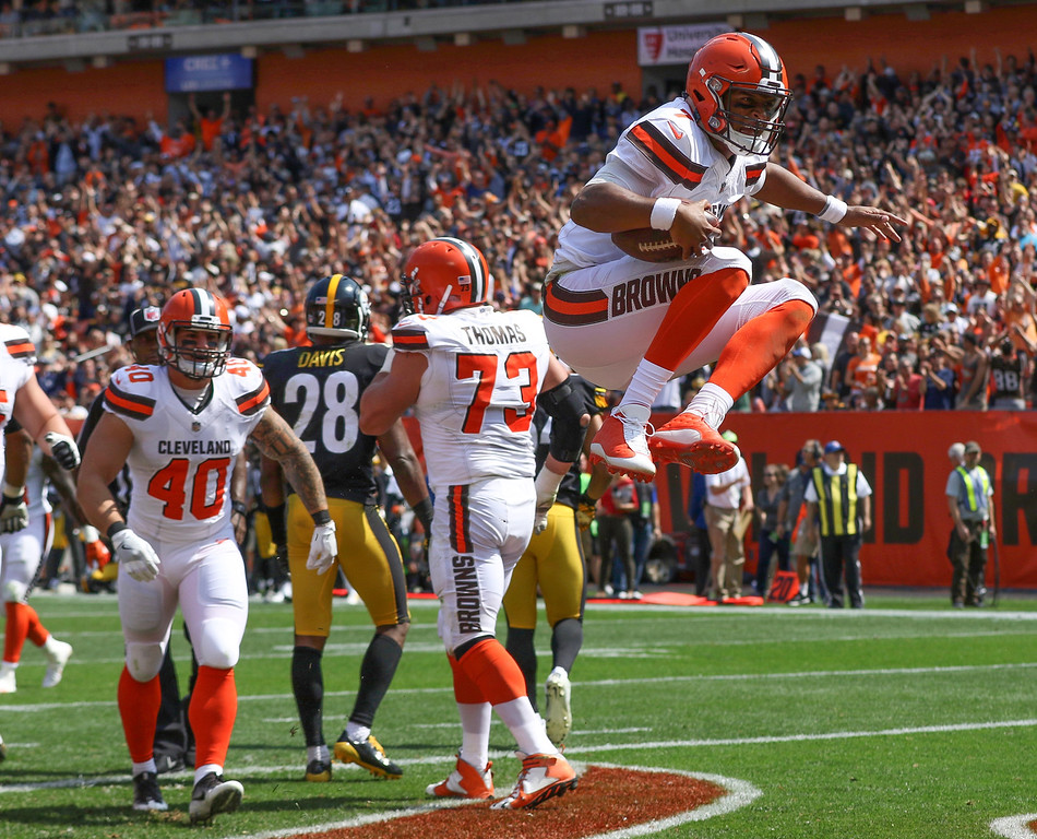. Tim Phillis - The News-Herald Browns quarterback DeShone Kizer celebrates his touchdown run against the Steelers on Sept. 10.