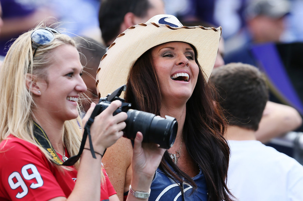 . Houston Texans fans take photos during warm ups before the start of the Baltimore Ravens and Houston Texans game at M&T Bank Stadium on September 22, 2013 in Baltimore, Maryland.  (Photo by Rob Carr/Getty Images)