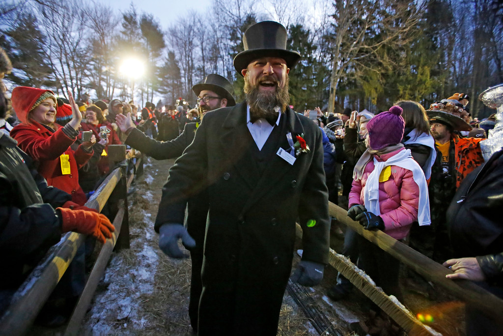 . A.J. Dereume of the Groundhog Club\'s inner circle makes his way to Gobbler\'s Knob during the 131st Groundhog Day celebration featuring Punxsutawney Phil, the weather prognosticating groundhog, in Punxsutawney, Pa. Thursday, Feb. 2, 2017. Phil\'s handlers said that the groundhog has forecast six more weeks of winter weather. (AP Photo/Gene J. Puskar)