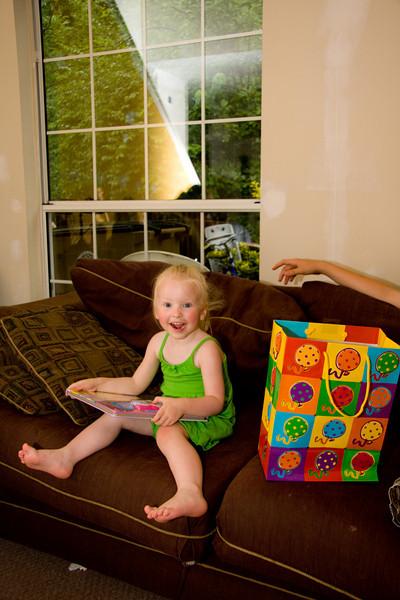 Chloe opening a birthday present, May 2009