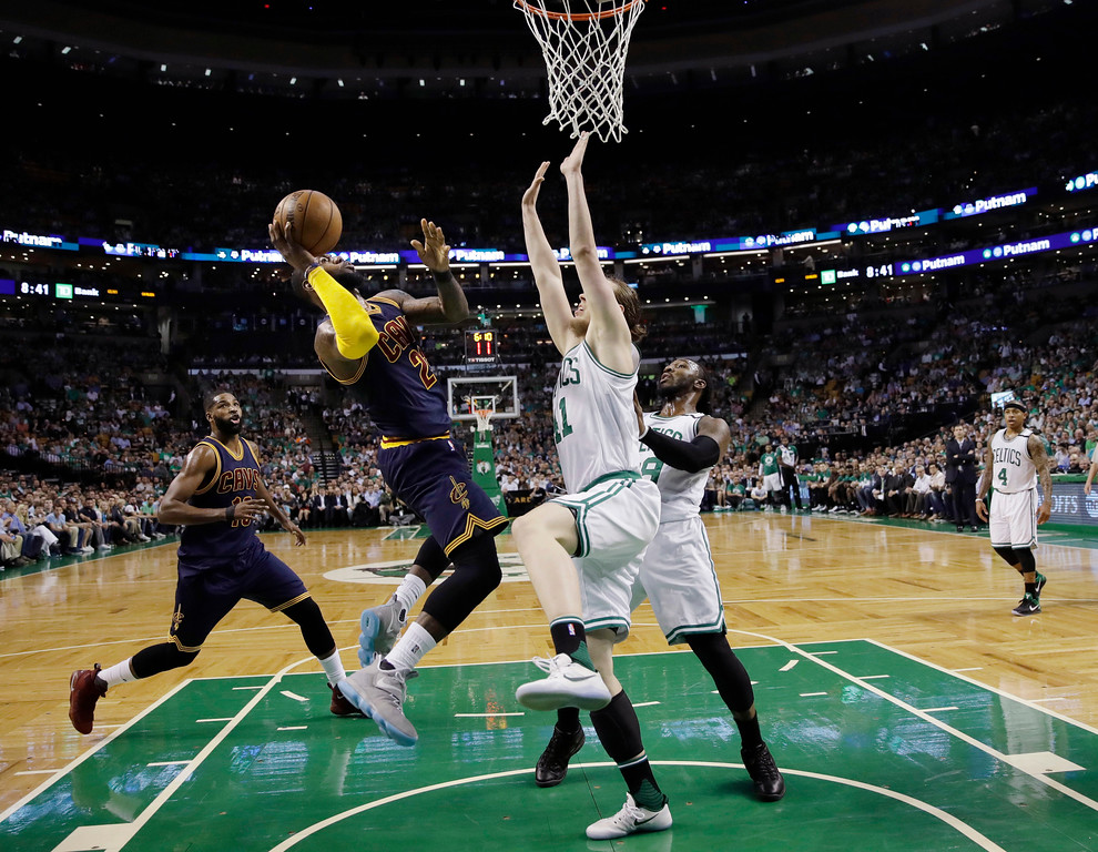 . Cleveland Cavaliers forward LeBron James shoots against Boston Celtics center Kelly Olynyk (41) during the first quarter of Game 1 of the NBA basketball Eastern Conference finals, Wednesday, May 17, 2017, in Boston. (AP Photo/Charles Krupa)