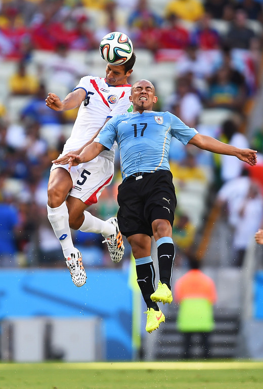 . Egidio Arevalo Rios of Uruguay goes up for a header with Celso Borges of Costa Rica during the 2014 FIFA World Cup Brazil Group D match between Uruguay and Costa Rica at Castelao on June 14, 2014 in Fortaleza, Brazil.  (Photo by Jamie McDonald/Getty Images)