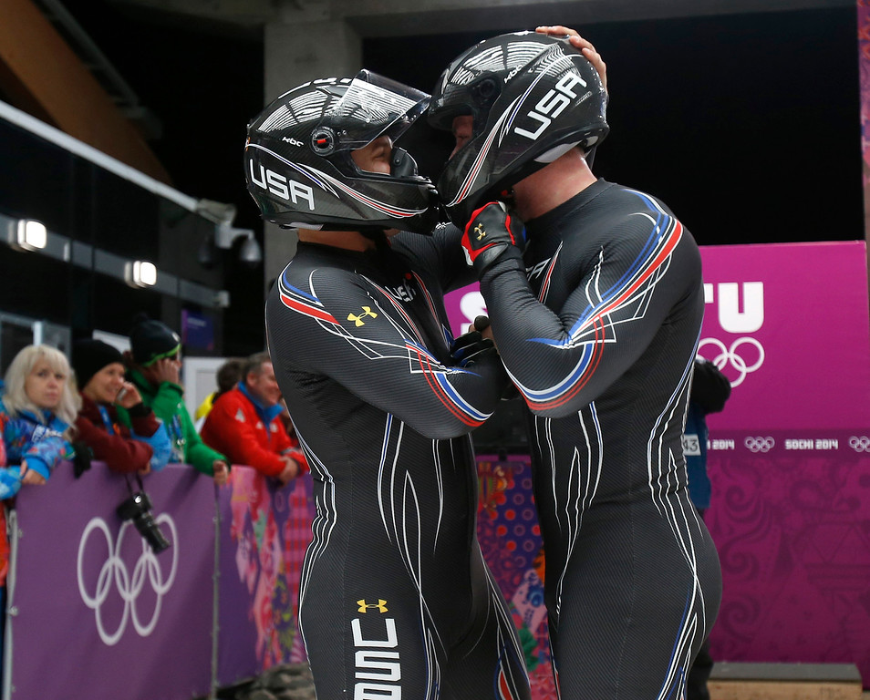 . USA-3 driven by Nick Cunningham, left, with Dallas Robinson celebrate their Heat 4 run for the Two-man Bobsleigh at the Sliding Center Sanki for the 2014 Winter Olympics in Krasnaya Polyana, Russia on Monday, Feb. 17, 2014.  (Nhat V. Meyer/Bay Area News Group)