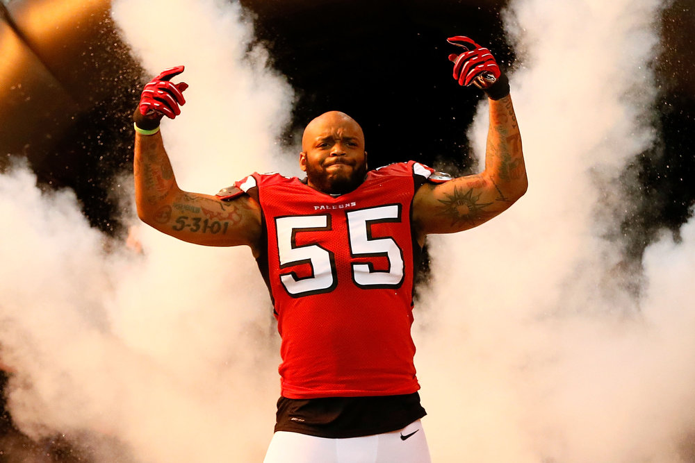 Description of . Defensive end John Abraham #55 of the Atlanta Falcons is introduced before the Falcons take on the San Francisco 49ers in the NFC Championship game at the Georgia Dome on January 20, 2013 in Atlanta, Georgia.  (Photo by Kevin C. Cox/Getty Images)