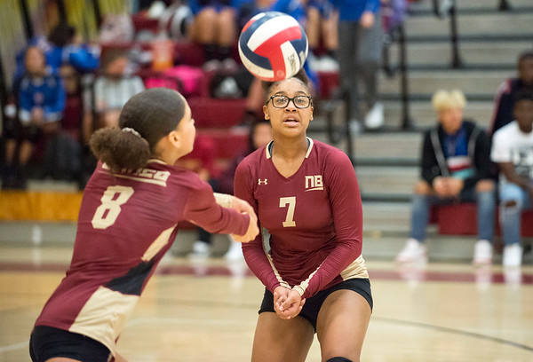 10/10/19 Wesley Bunnell | StaffrrNew Britain girls volleyball vs Tolland at New Britain High School on Thursday evening. Anyennia Lugo (7) looks on as Maleah Echevarria (8) plays the ball.