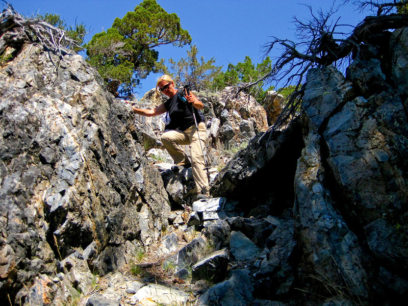 Climbing down multiple rocky ridges to reach point to see Silver Lake. See map Blue line