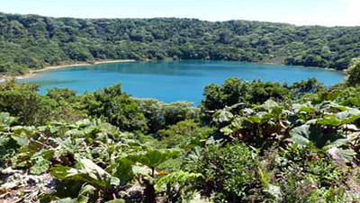 Hike up from the Poas Volcano crater and you will find Botas Lagoon, an inactive crater filled with water.