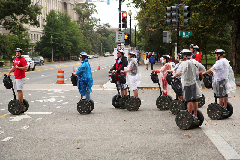 An odd Segway group tours the dity.