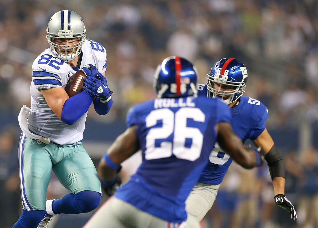 . Tight end Jason Witten #82 of the Dallas Cowboys runs after a catch against Antrel Rolle #26 of the New York Giants in the first half on September 8, 2013 at AT&T Stadium in Arlington, Texas.  (Photo by Ronald Martinez/Getty Images)