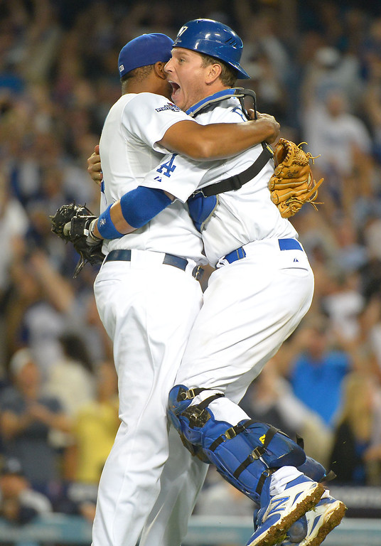 . A.J Ellis and Kenley Jansen celebrate after defeating the Braves Monday, October 7, 2013 ( Photo by Andy Holzman/Los Angeles Daily News )