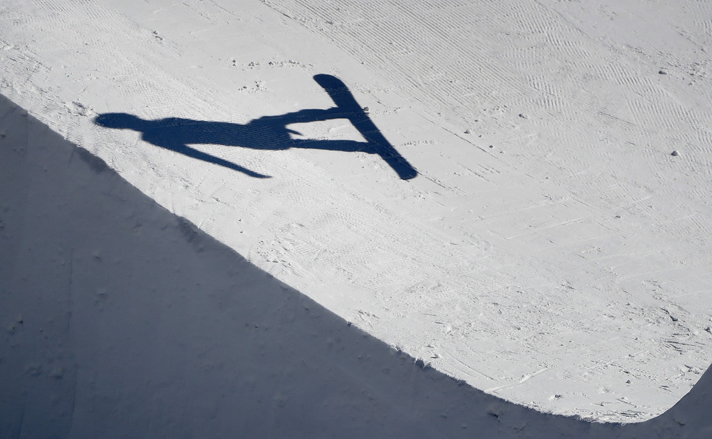 . Jerome Lymann, of Switzerland, jumps during the men\'s snowboard cross seeding run at Phoenix Snow Park at the 2018 Winter Olympics in Pyeongchang, South Korea, Thursday, Feb. 15, 2018. (AP Photo/Gregory Bull)
