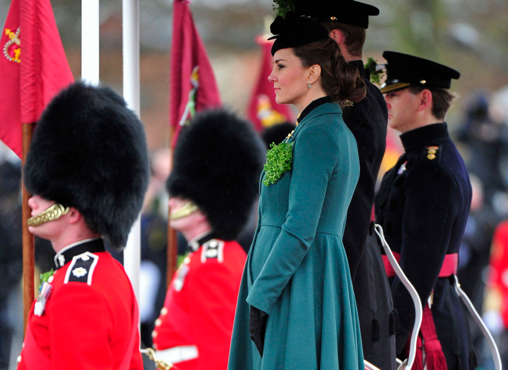 . Britain\'s Catherine, Duchess of Cambridge and her husband, Prince William, attend a St Patrick\'s Day Parade at Mons Barracks in Aldershot, southern England on March 17, 2013.  Prince William attended the parade as Colonel of the Regiment, and the Duchess presented the traditional sprigs of shamrocks to the Officers and Guardsmen of the Regiment.    REUTERS/Toby Melville