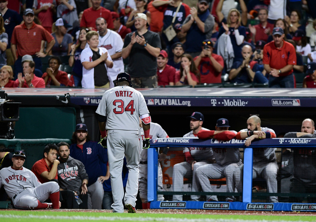 . Boston Red Sox\'s David Ortiz (34) walks to the dugout after flying out against the Cleveland Indians during the ninth inning of Game 2 of a baseball American League Division Series, Friday, Oct. 7, 2016, in Cleveland. Cleveland won 6-0. (AP Photo/David Dermer)