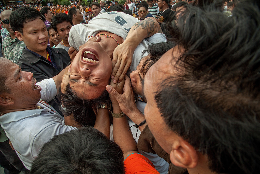 . A Thai devotee in state of trance is helped by volunteers during the celebration of the annual Tattoo festival at Wat Bang Phra on March 15, 2014 in Nakhon Pathom, Thailand.  (Photo by Omar Havana/Getty Images)