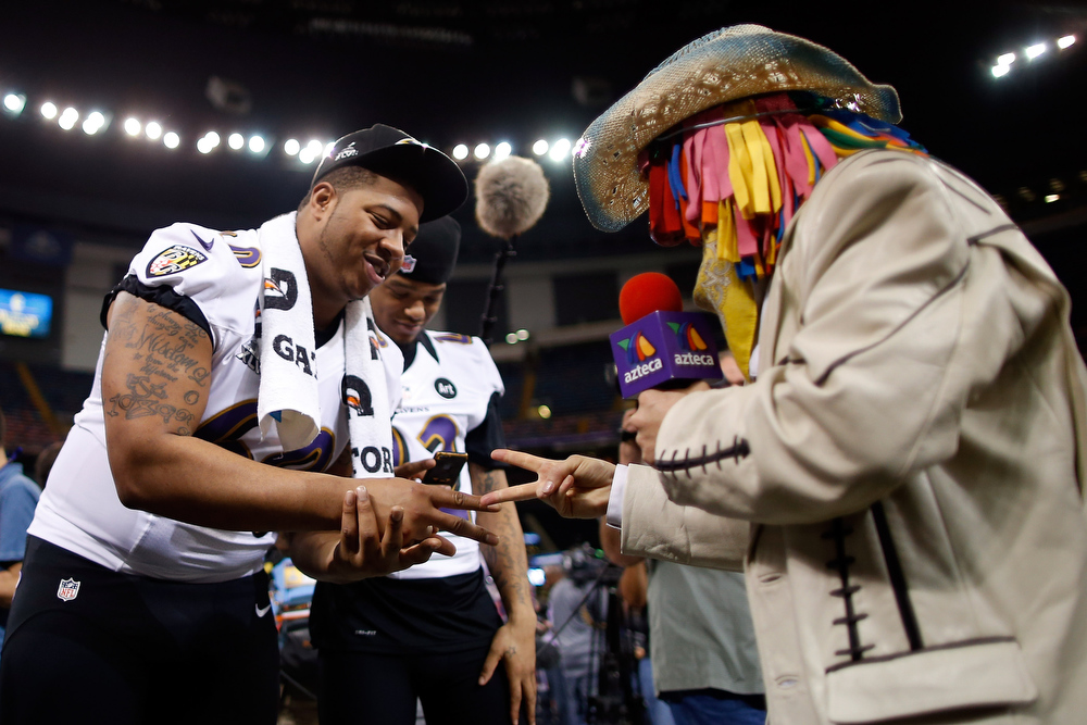 Description of . Antoine McClain #60 of the Baltimore Ravens plays rock, paper, scissors during Super Bowl XLVII Media Day ahead of Super Bowl XLVII at the Mercedes-Benz Superdome on January 29, 2013 in New Orleans, Louisiana. The San Francisco 49ers will take on the Baltimore Ravens on February 3, 2013 at the Mercedes-Benz Superdome.  (Photo by Chris Graythen/Getty Images)