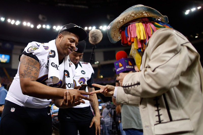 . Antoine McClain #60 of the Baltimore Ravens plays rock, paper, scissors during Super Bowl XLVII Media Day ahead of Super Bowl XLVII at the Mercedes-Benz Superdome on January 29, 2013 in New Orleans, Louisiana. The San Francisco 49ers will take on the Baltimore Ravens on February 3, 2013 at the Mercedes-Benz Superdome.  (Photo by Chris Graythen/Getty Images)