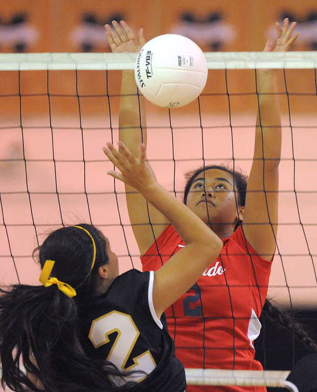 . Redondo girls volleyball takes on Bishop Montgomery in a non league match in Torrance on 09/10/2013. Redondo won 3-0. Redondo\'s Norene Iosia blocks a shot at the net by Stephany Garcia. (Photo by Scott Varley, Daily Breeze)