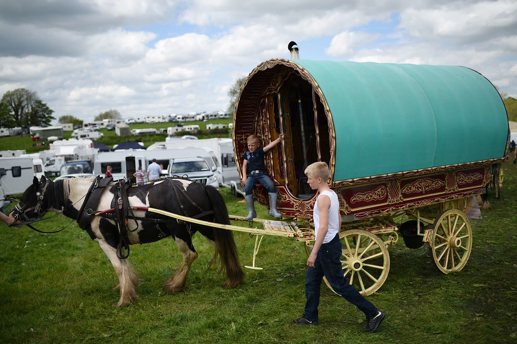. People park their vardo, or horse-drawn caravan, on the opening day of the annual Appleby Horse Fair, in the town of Appleby-in-Westmorland, North West England on June 4, 2015. The annual event attracts thousands of travelers from across Britain to gather and buy and sell horses. AFP PHOTO / OLI  SCARFF/AFP/Getty Images