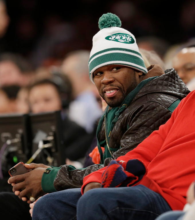. Rapper 50 Cent watches during the second half of the NBA basketball game between the New York Knicks and the Los Angeles Lakers at Madison Square Garden Sunday, Jan. 26, 2014, in New York. The Knicks defeated the Lakers 110-103. (AP Photo/Seth Wenig)