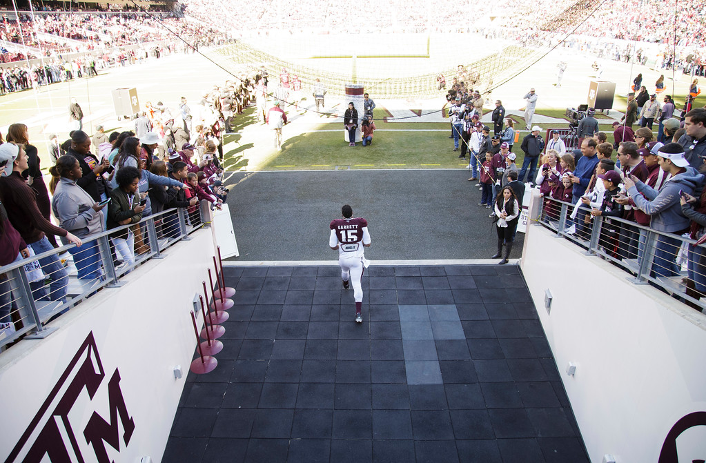 . Texas A&M defensive lineman Myles Garrett (15) enters Kyle Field for the coin toss before the start of an NCAA college football game against UTSA Saturday, Nov. 19, 2016, in College Station, Texas. (AP Photo/Sam Craft)