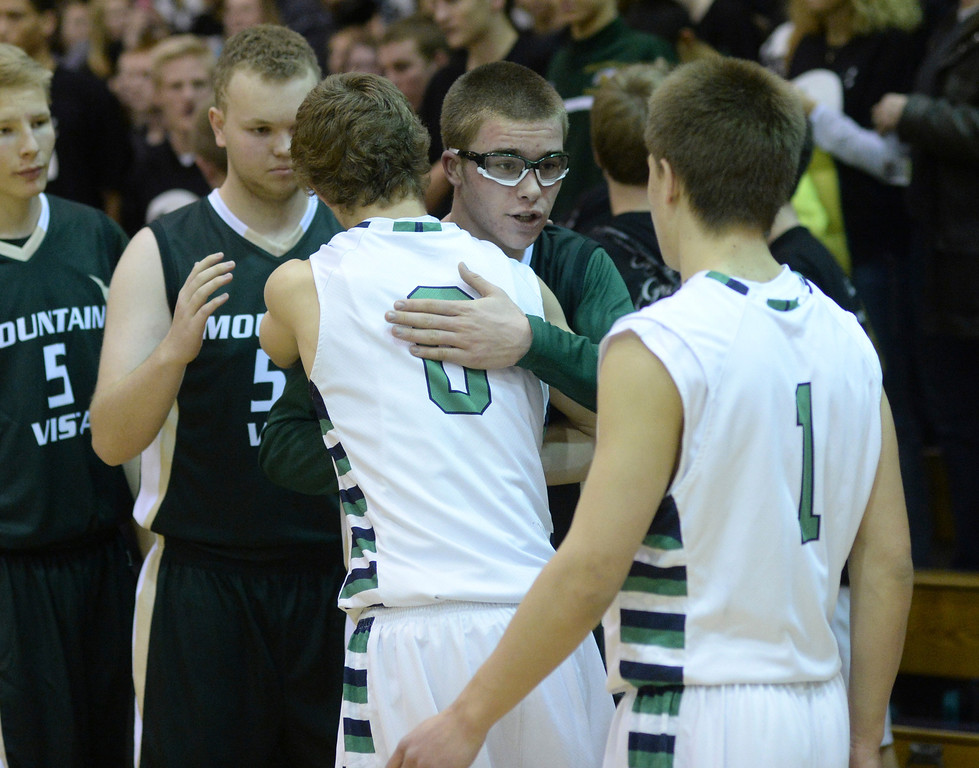 . HIGHLANDS RANCH, CO. - FEBRUARY 7, 2014: The rivalry ended with handshakes following the Mountain Vista win. The Mountain Vista High School boy\'s basketball team defeated ThunderRidge 60-50 Friday night, February 7, 2014. Photo By Karl Gehring/The Denver Post