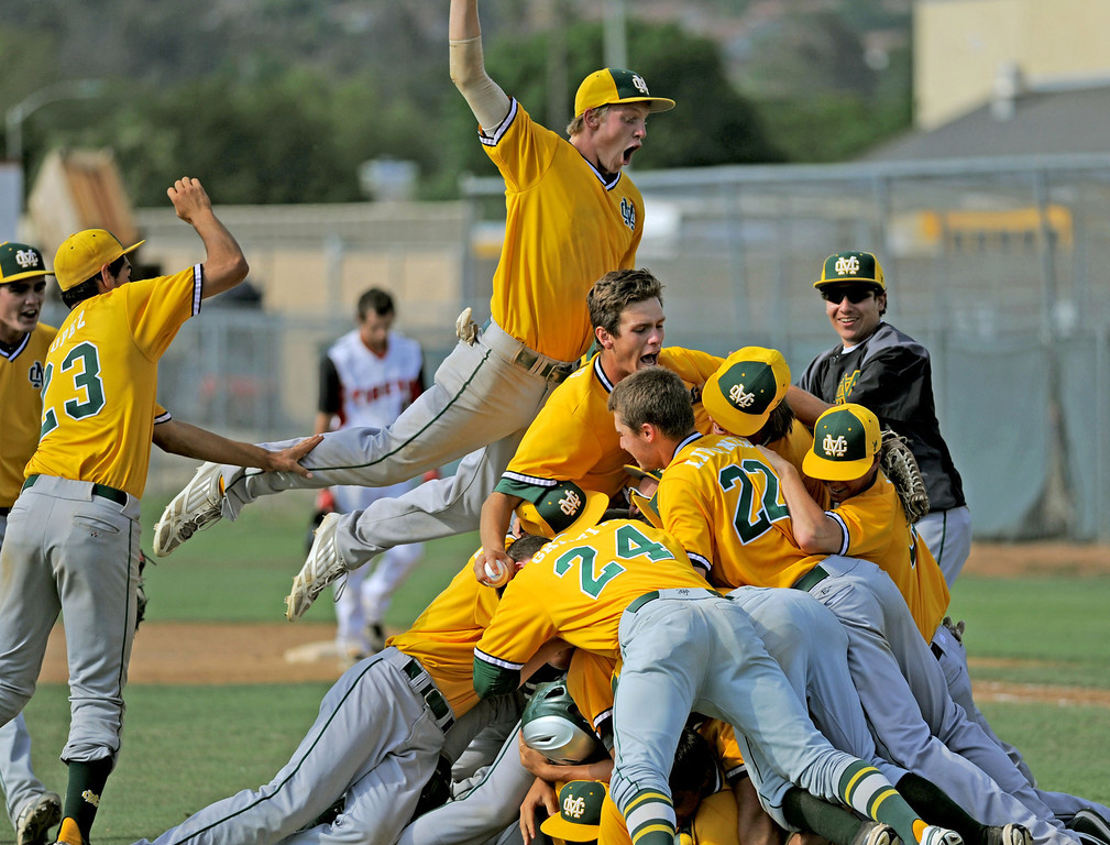 . 05-28-2013-( Sean Hiller/LANG) Mira Costa celebrates its 5-3 victory over Elsinore in Tuesday\'s CIF Southern Section Division III semifinal at Elsinore High School.