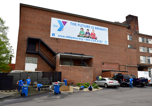 5/4/2019 Mike Orazzi   Staff Comcast volunteers while cleaning up the New Britain Berlin YMCA as part of the 18th annual Comcast Cares Day on High Street in New Britain Saturday.