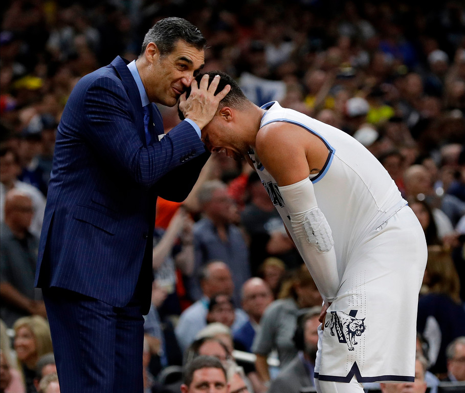 . Villanova head coach Jay Wright hugs Jalen Brunson as they celebrate after the championship game of the Final Four NCAA college basketball tournament against Michigan, Monday, April 2, 2018, in San Antonio. Villanova won 79-62.(AP Photo/David J. Phillip)