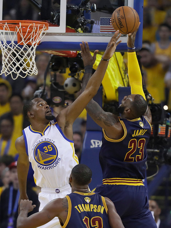 . Cleveland Cavaliers forward LeBron James (23) shoots against Golden State Warriors forward Kevin Durant (35) during the first half of Game 1 of basketball\'s NBA Finals in Oakland, Calif., Thursday, June 1, 2017. (AP Photo/Marcio Jose Sanchez)