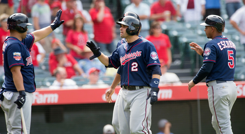 . The Minnesota Twins player celebrate after scoring three runs in the ninth inning the Angels at Angel Stadium in Anaheim on Thursday June 26, 2014. The Angels beat the Minnesota Twins 6-4. (Photo by Keith Durflinger/Whittier Daily News)