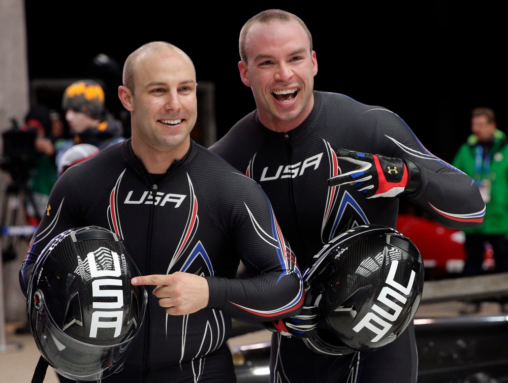 . The team from the United States USA-3, piloted by Nick Cunningham, left, and brakeman Dallas Robinson, smile after their final run during the men\'s two-man bobsled competition at the 2014 Winter Olympics, Monday, Feb. 17, 2014, in Krasnaya Polyana, Russia. (AP Photo/Jae C. Hong)