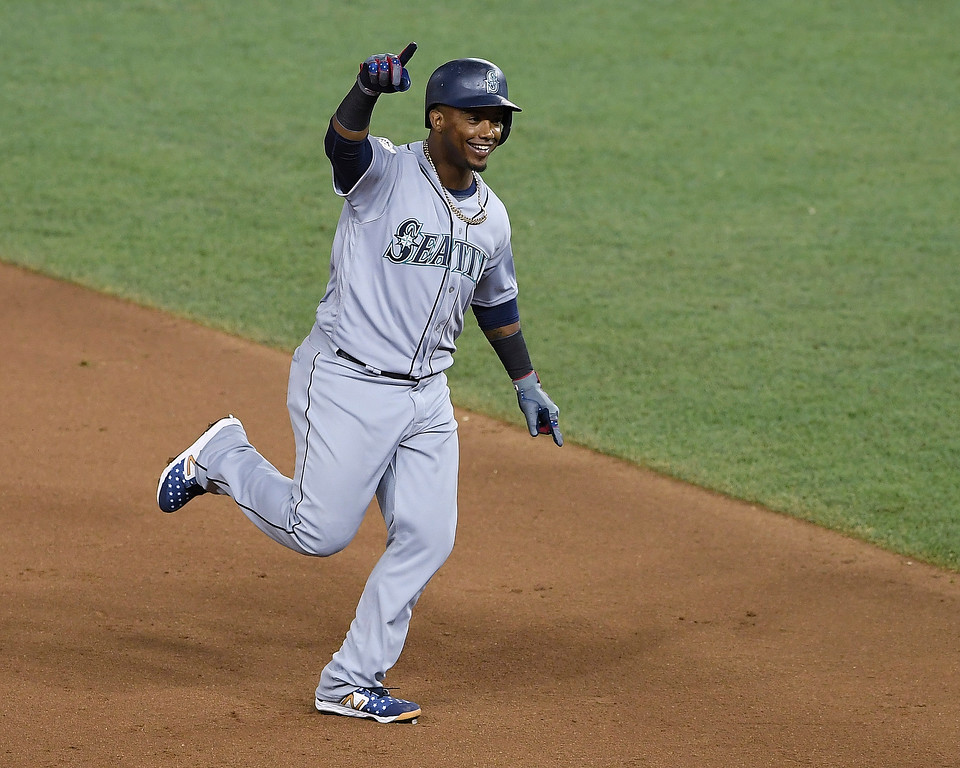 . Seattle Mariners Jean Segura (2) points the bench as he rounds the bases on a three-run homer in the eighth inning during the Major League Baseball All-star Game, Tuesday, July 17, 2018 in Washington. (AP Photo/Nick Wass)
