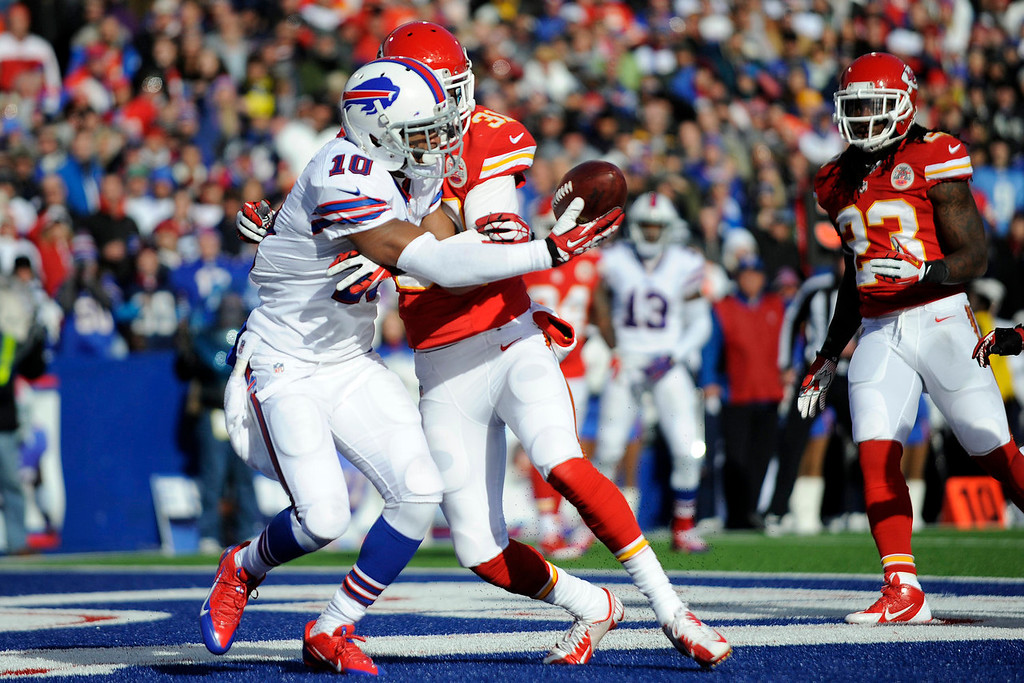 . Buffalo Bills wide receiver Robert Woods (10) is hit by Kansas City Chiefs cornerback Marcus Cooper (31) and can\'t hang onto a pass in the endzone during the second quarter of an NFL football game in Orchard Park, N.Y., Sunday, Nov. 3, 2013. (AP Photo/Gary Wiepert)