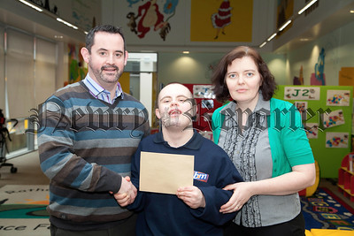 Conor Quinn, past pupils visits Rathore following a cheque presentation of £300 last term. Conor represents Niall Quinn and Whitegates Community business. This money will fund a Science workshop and purchase some PE equiptment. Pictutred with Conor is Teacher Pat Mathers and Acting VP Dolores Morgan. R1404012